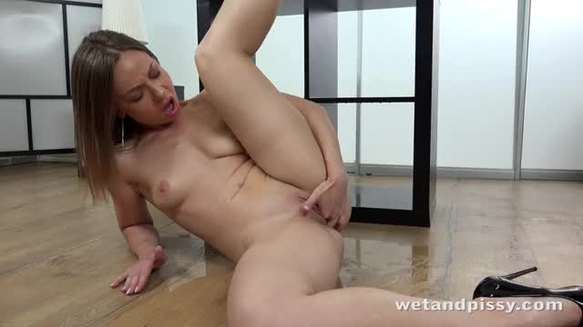 sexy beauty in ebony high heels pees all over the floor