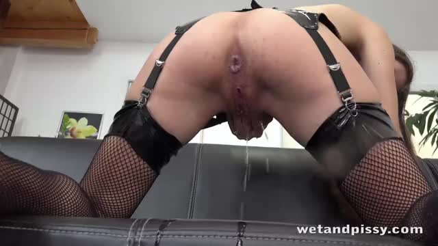 cute dark brown Stefany having some pee fun, dressed up in shiny PVC & fishnet nylons