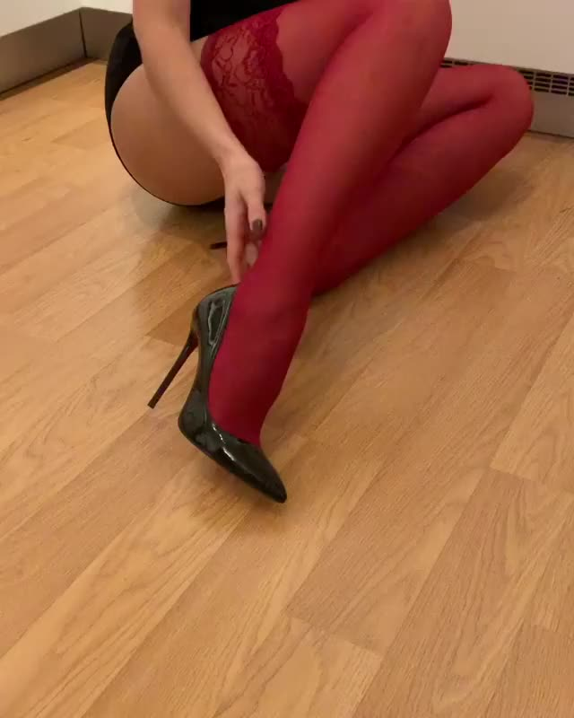 taking off her high heels and nylons, but not her hose
