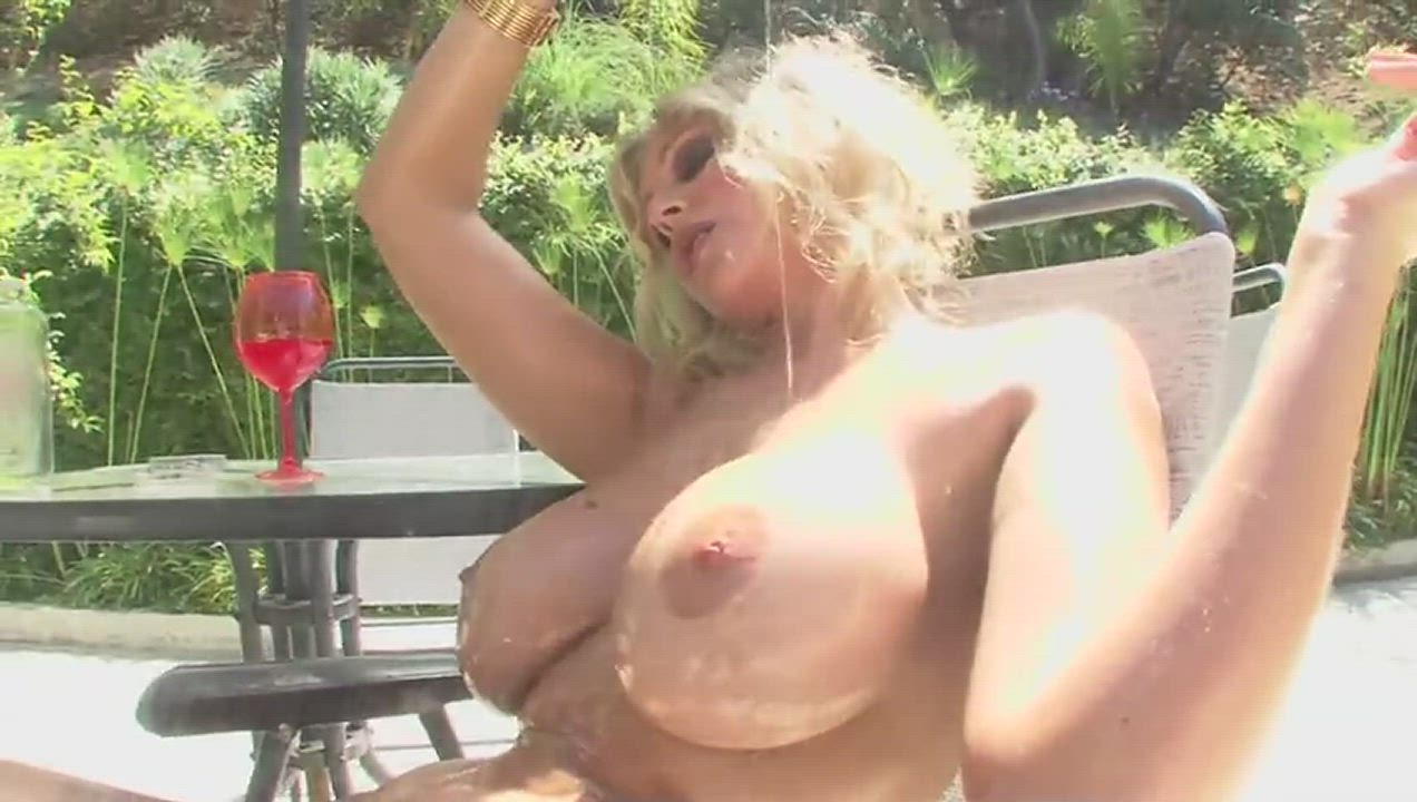 Oiling herself up