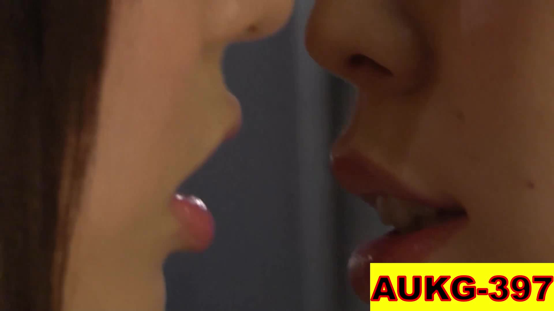 Couple of women softly tongue kiss