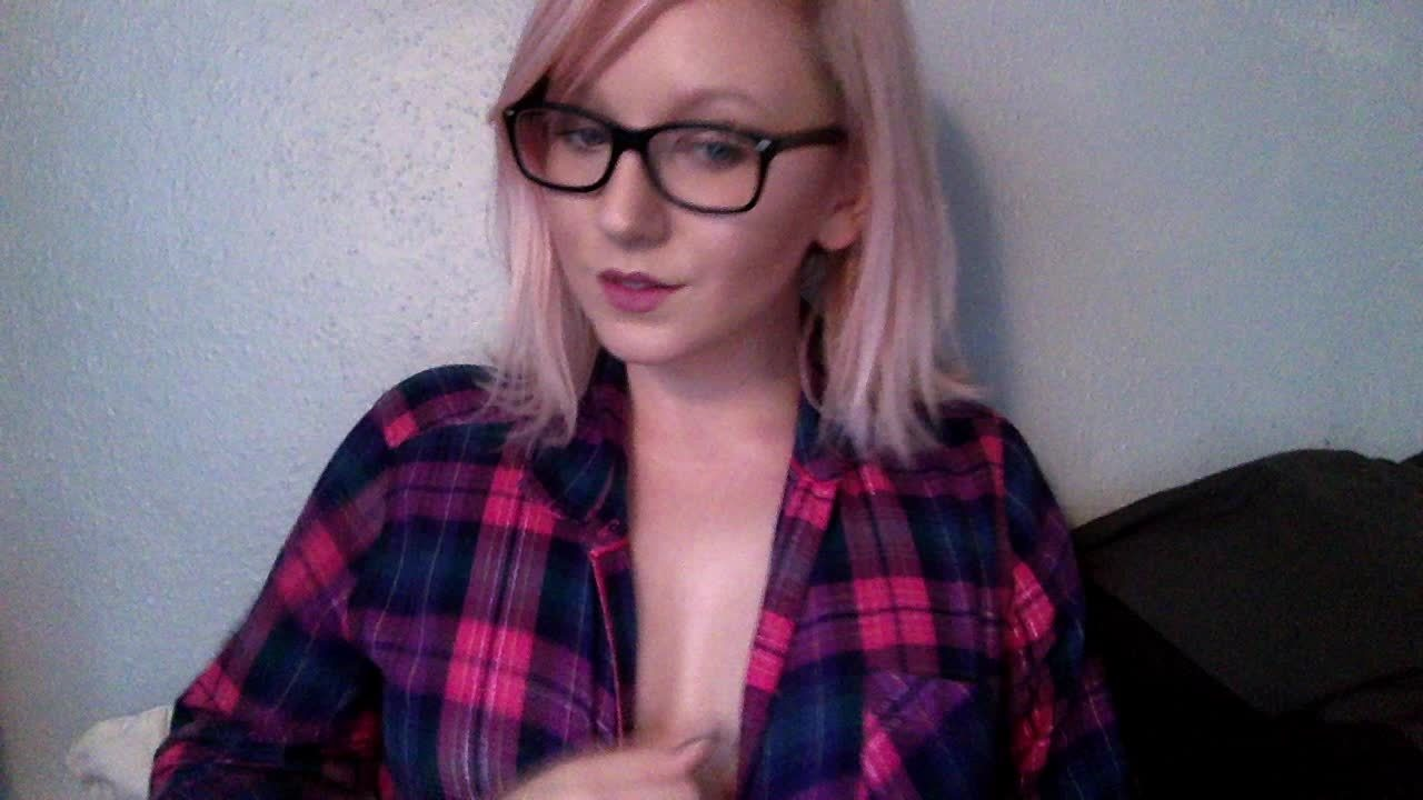 Pink hair and glasses