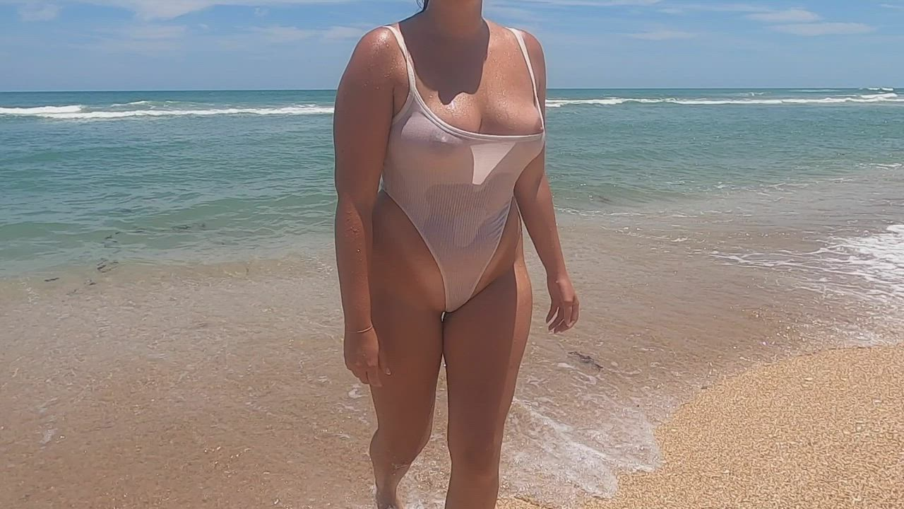 Showing off my white one piece on the beach