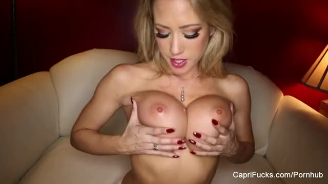 Capri playing with her boobs