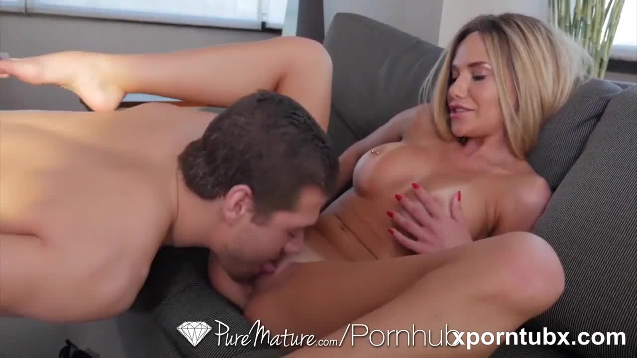 Tan lined MILF Subil Arch fucks the bell boy