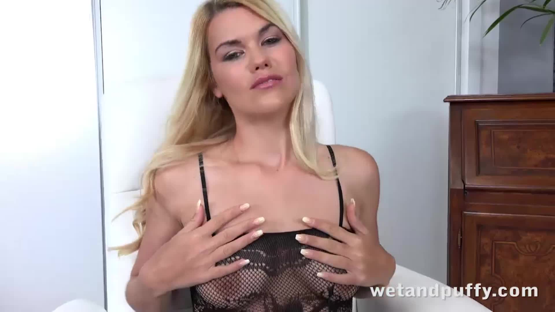 Blonde Delphine masturbating and toying her puffy pussy to orgasm