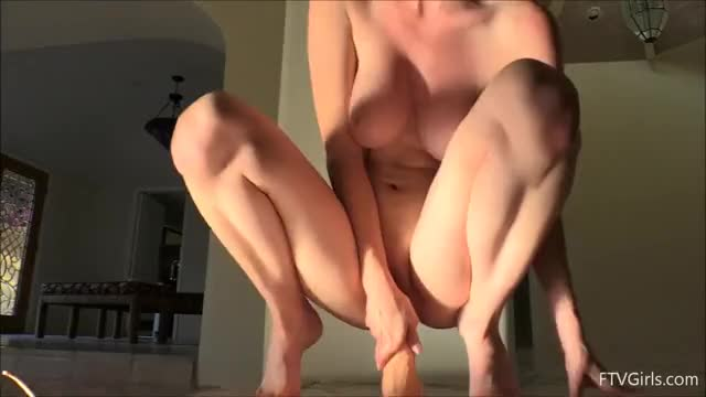 Bouncing on her dildo