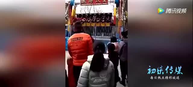 Young lady is dangled and then thrown from amusement park ride