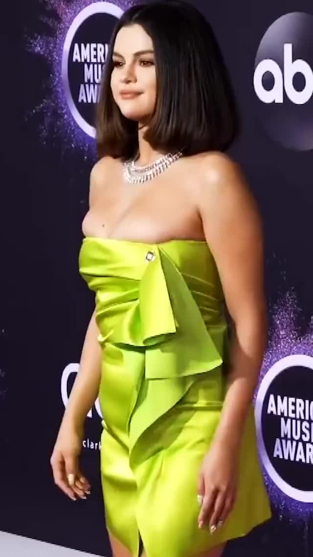 Selena Gomez's sexy dress can barely contain her fabulous boobs in sexy video