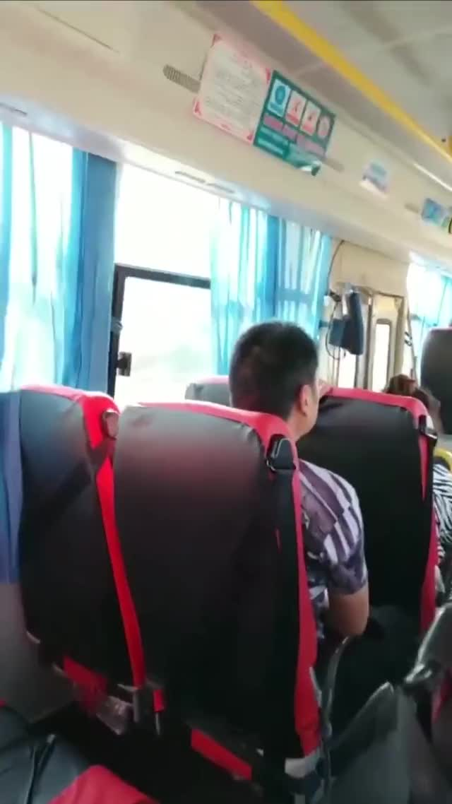 chinese cutie flashing her meatballs on a bus