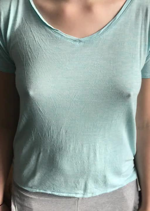 Bouncing her small tits around under her shirt