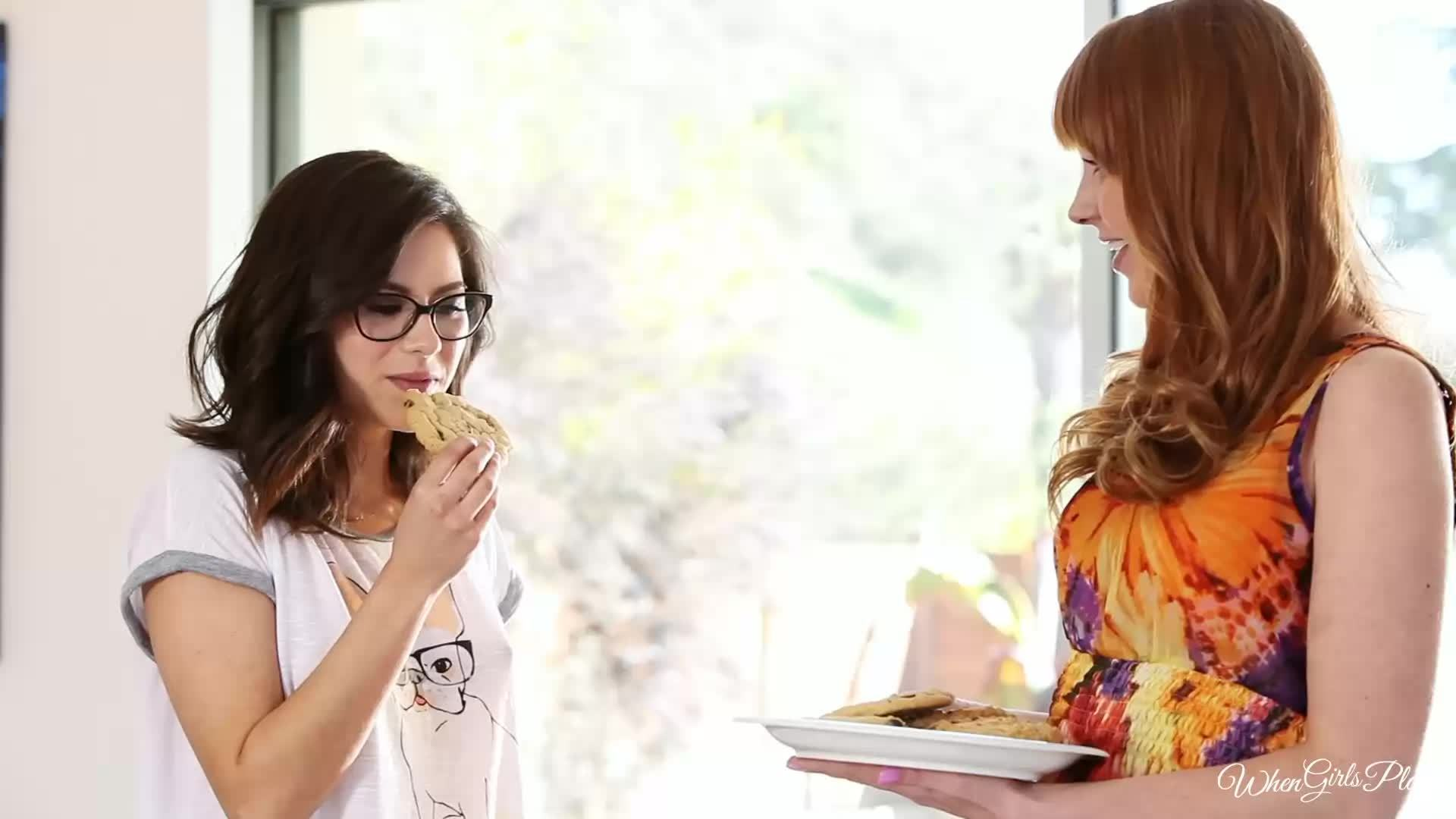 Marie McCray and Shyla Jennings sharing some cookies