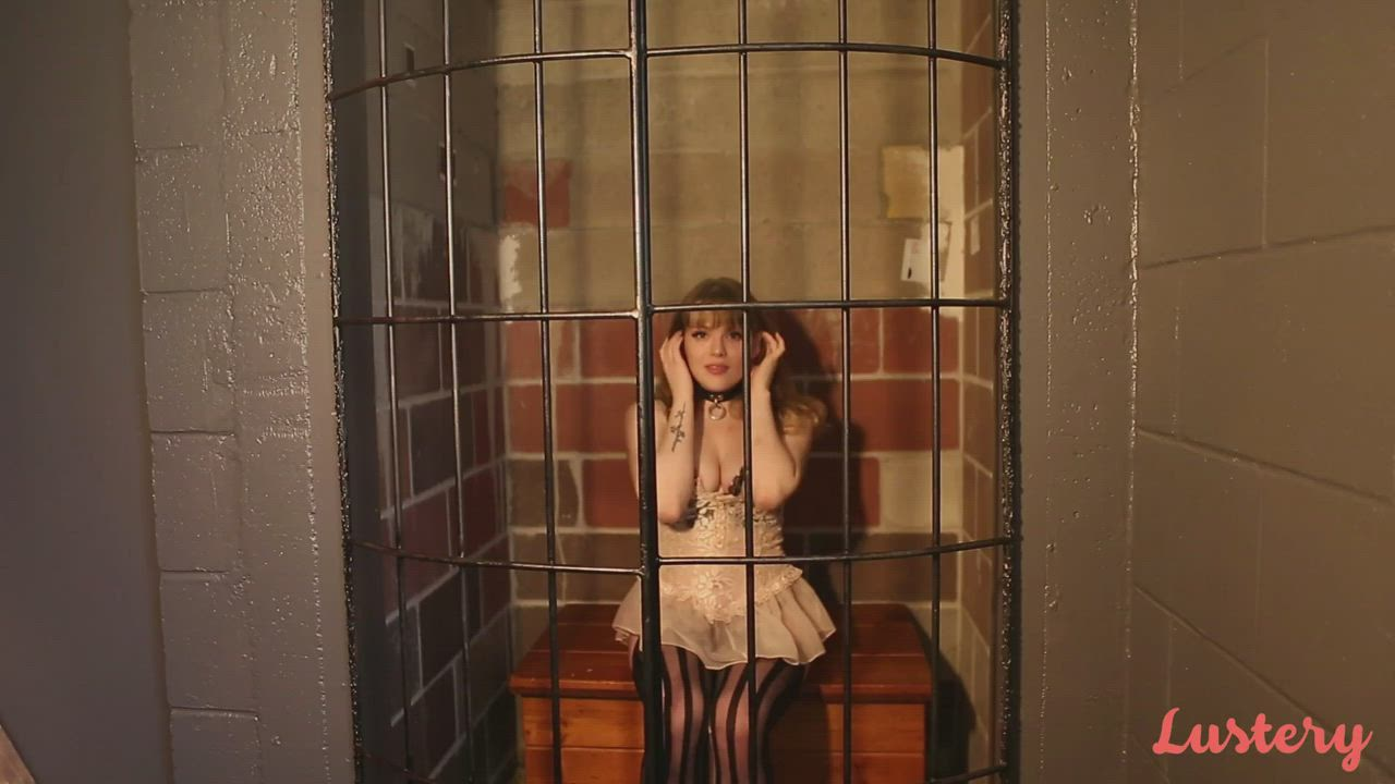 In her cage.