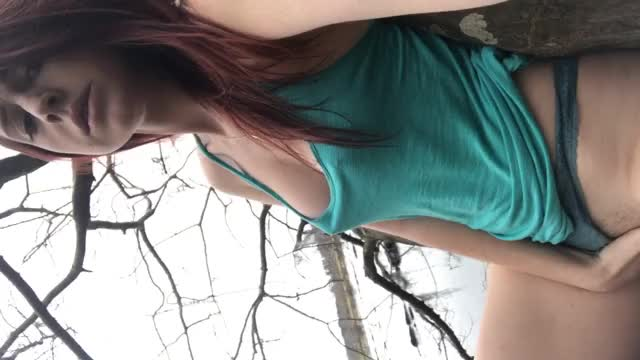 Redhead fingers herself in a tree during nature walk [GIF]