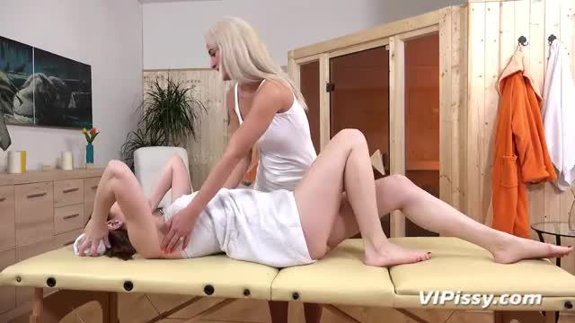 a massage ends up in some sexy lesbo action and pee exchange