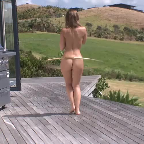 Remy LaCroix hula hooping outdoors