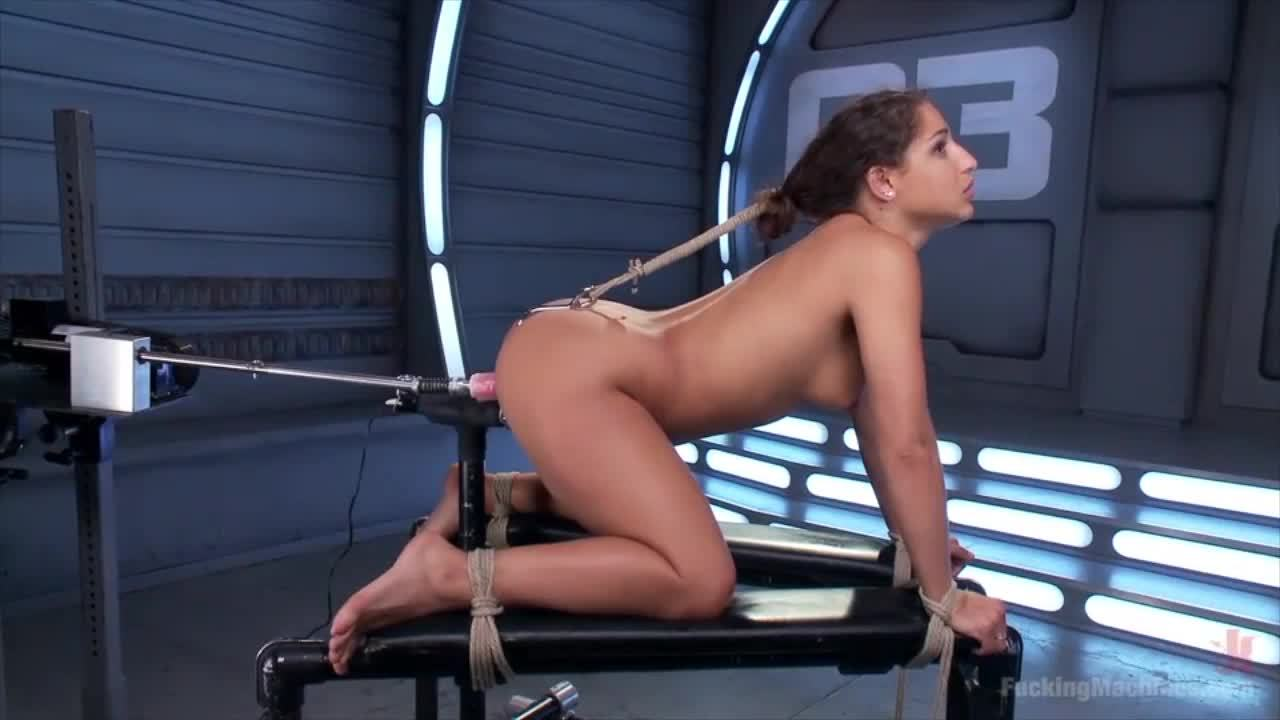 Bound doggy style with an ass hook and fucked with a machine.
