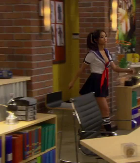 Brenda Song dressed in a mini skirt