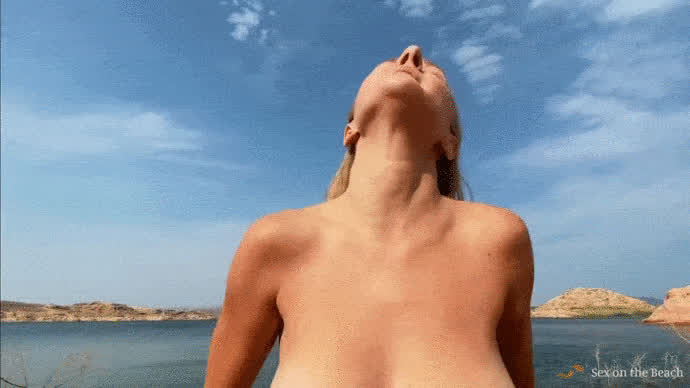 Busty Mature Relaxing on the Beach