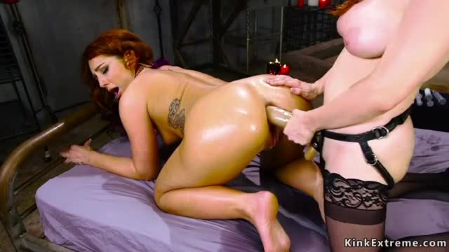 gaping aged dark hole with a strap-on