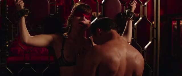 dakota Johnson fastened up in fifty shades freed