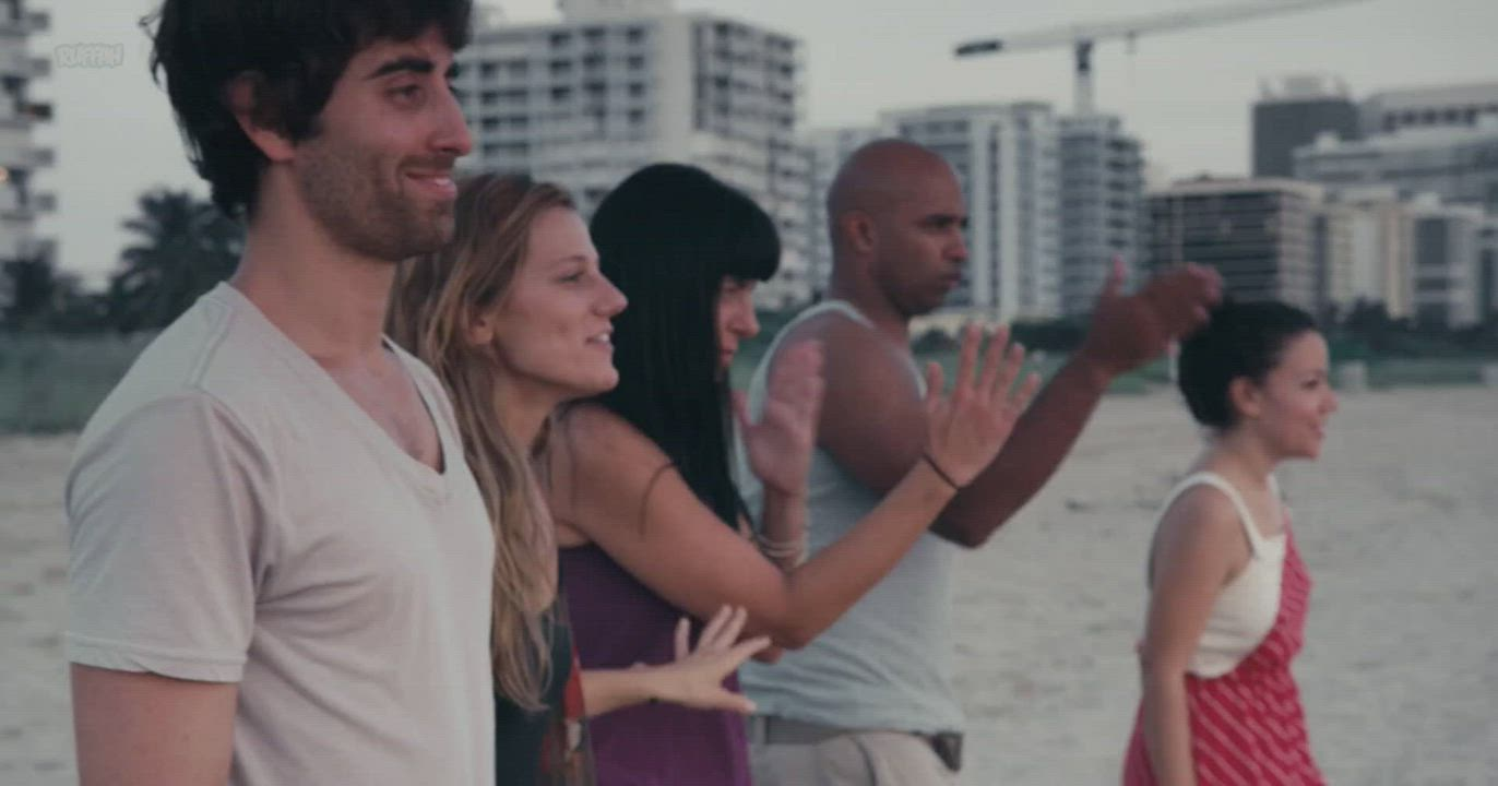 Skinny-dipping with new friends in Miami Beach, then Vanessa (Kandis Kay) have a casual smoke break with Diego. (After the Wedding (US2017))