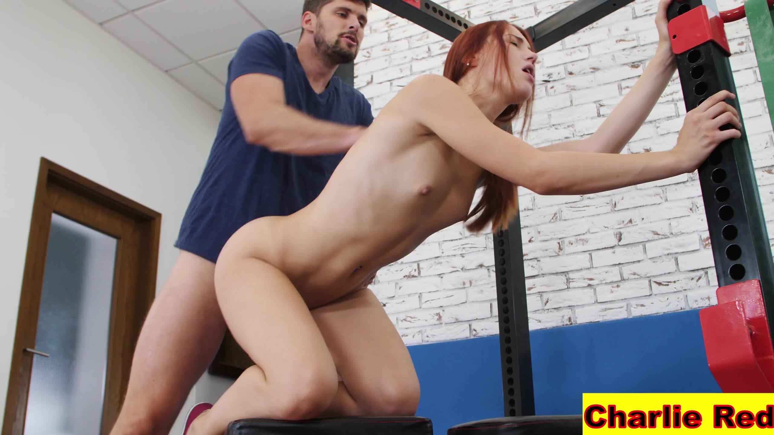 Gorgeous redhead Charlie Red fucked and squirts
