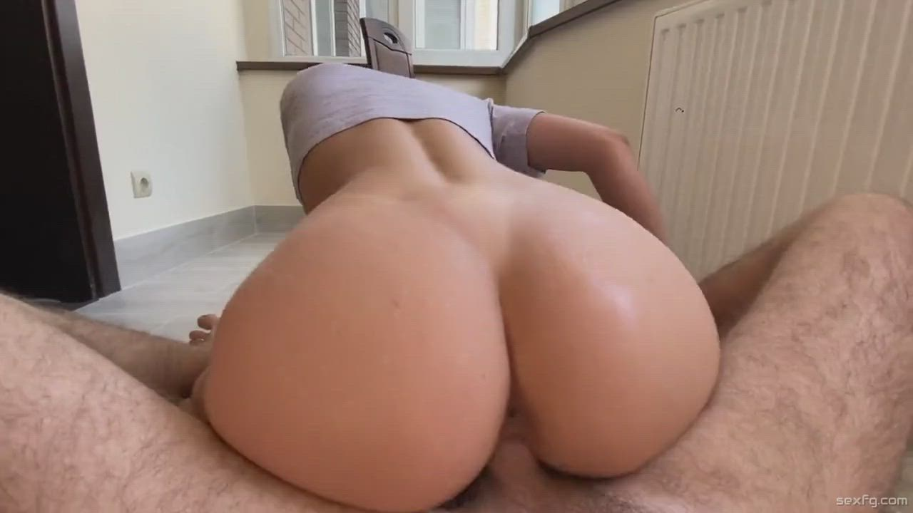 Hot blonde rides a cock in front of window